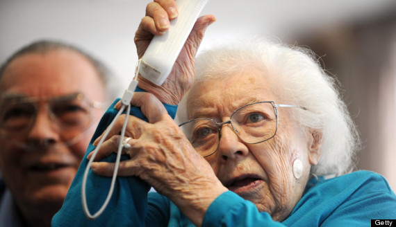 (JS) WiiTOURNAMENT-- Juanita Rutland, 91, of Heritage Club of Greenwood Village is in the Wii Bowling tournament against seniors from St. Andrews Village in Aurora on Tuesday. Rutland scored 123 in the 1st round. Residents of Heritage Club of Greenwood in