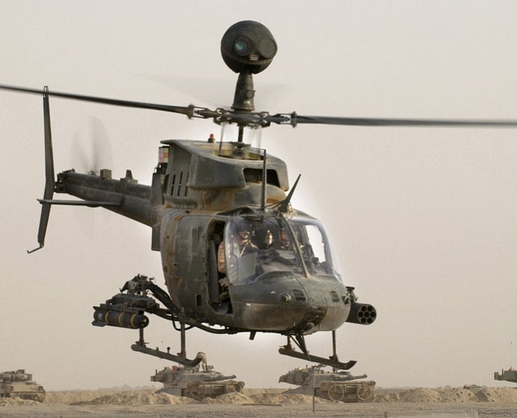 (An OH-58D Kiowa Warrior helicopter from the 1st Infantry Division takes off on a mission from Forward Operation Base MacKenzie, Iraq. It is armed with an AGM-114 Hellfire and 7 Hydra 70 rockets. Credit : SSgt Shane A. Cuomo, US Army )