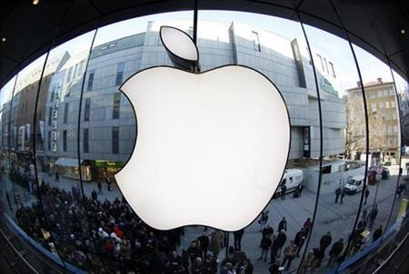 People wait on street in front of Apple store as they await sales of new iPad in Apple store in Munich
