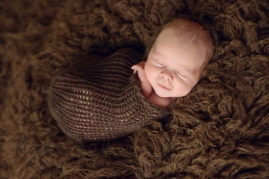 baby_wrapped_sleeping_pose_smile_Lower_Mainland