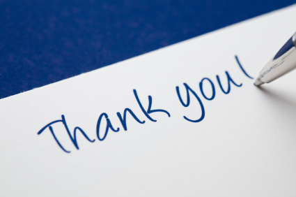In the process of writing a thank you card.  See also: [url=/file_closeup.php?id=6099723][img]/file_thumbview_approve.php?size=2&id=6099723[/img][/url]