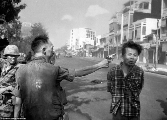 South_Vietnamese_police_chief_Nguyen_Ngoc_Loan_executes_a_handcu