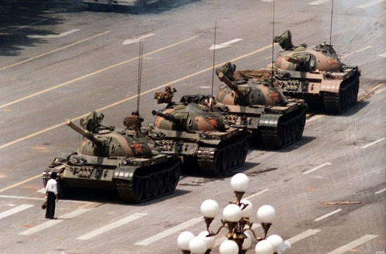 A Chinese protestor blocks a line of tanks heading east on Beijing's Changan Blvd. June 5, 1989 in front of the Beijing Hotel. The man, calling for an end to the violence and bloodshed against pro-democracy demonstrators at Tiananmen Square, was pulled away by bystanders, and the tanks continued on their way.
