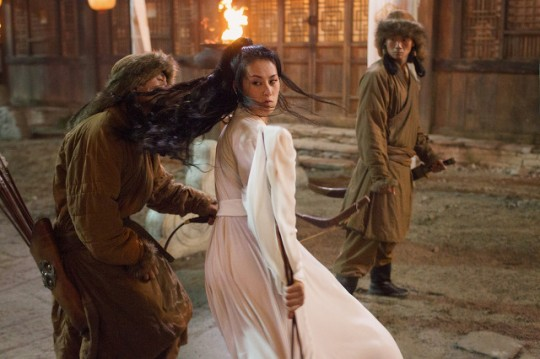 "Olivia Cheng (C) in a scene from Netflix's ""Marco Polo."" Photo Credit: Phil Bray for Netflix."