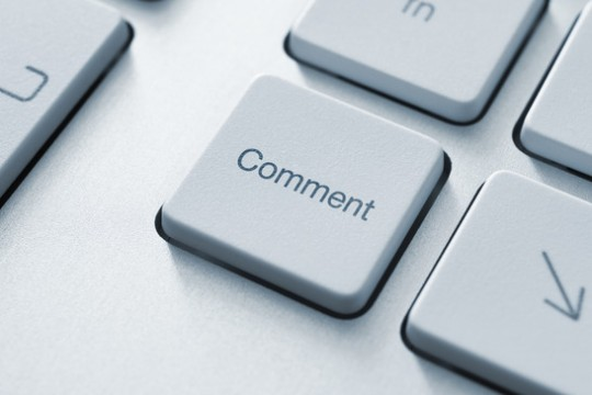 Comment button on the keyboard. Toned Image.