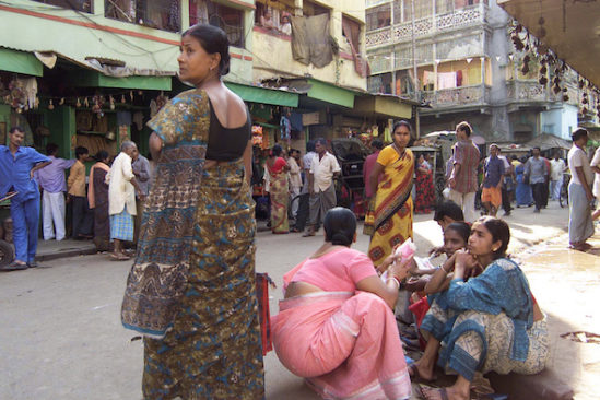 """Sex workers wait for customers at Calcutta's red-light district called Sonagachi, India, Monday Feb. 28, 2005. Ross Kauffman, a 1989 graduate of URI, and Zana Briski won an Oscar on Sunday for their documentary """"Born Into Brothels"""", which documents the lives of children of prostitutes in the red light district of Calcutta. (AP Photo/Bikas Das)"""