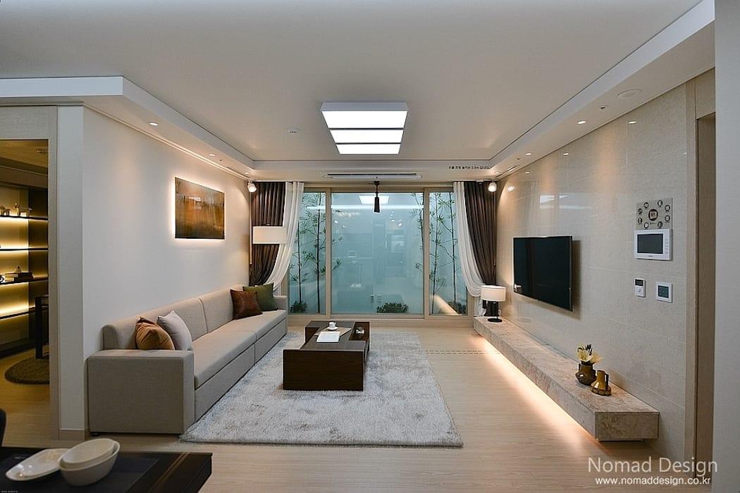 부산 호텔을 콘셉트로 한 24평 아파트(2): 노마드디자인/Nomad design의 거실