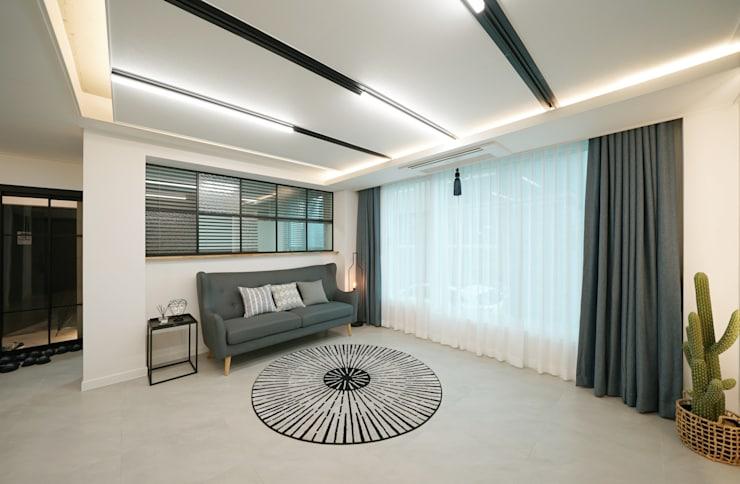 거실: 디자인 아버의 거실